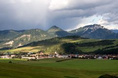 Rain over the landscape. Rainbow over a dazzling cloud. Slovak country. The sun shone royalty free stock photography