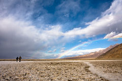 Rainbow over Death Valley. Rainbow and a stormy sky over Badwater in Death Valley National Park, California royalty free stock photo