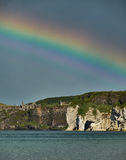 Rainbow over Dunluce Castle, Northern Ireland Stock Photos