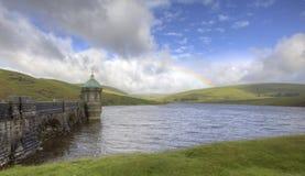 Rainbow over the Elan Valley. Rainbow over the Elan Valey dam Royalty Free Stock Photography