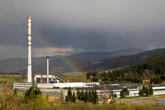 Rainbow over a factory Royalty Free Stock Image