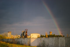 Rainbow over the factory chimneys. Thermal power plant in the rain. Stock Photography