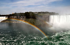 Rainbow over the falls. Image of a rainbow at Niagara falls stock photo