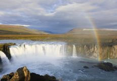 Rainbow over Godafoss waterfall in Iceland Stock Photography
