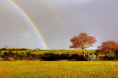 Rainbow over a farm Royalty Free Stock Image
