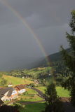 Rainbow over Farmhouses Royalty Free Stock Image