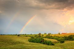 Rainbow over farmland in Central Kentucly stock photography