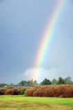 Rainbow over a field Stock Photography