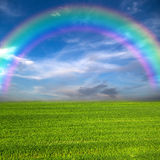 Rainbow over field Royalty Free Stock Image