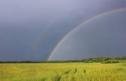 Rainbow over the field, Novgorod region, Russia Stock Photography