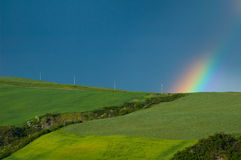 Rainbow over fields Stock Image