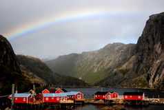 Rainbow over Fishing Village Stock Photography