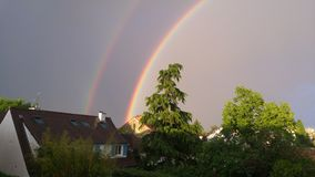 Rainbow over french houses Paris Royalty Free Stock Images