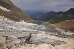 Rainbow over the glacier. Stock Photos