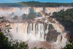 Rainbow over gorgeous waterfalls of Iguazu, Brazil Stock Photography