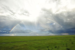 Rainbow over the grassland. Photographed on the way back to Hailar after a sudden shower stock photos