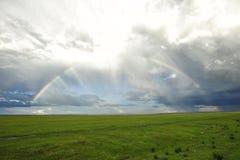 Rainbow over the grassland Stock Photos
