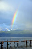 Rainbow over  Great lake prespa, macedonia Royalty Free Stock Photo