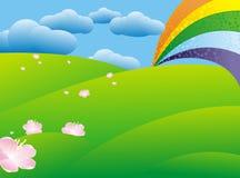 Rainbow over green meadow Stock Photos