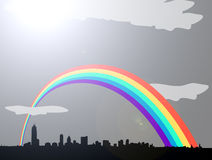 Rainbow over grey cloudy city skyline Stock Photo