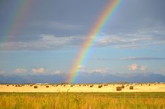 Rainbow over a hay field. San Luis Valley, Colorado Royalty Free Stock Photos