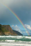 Rainbow over headland Royalty Free Stock Photo