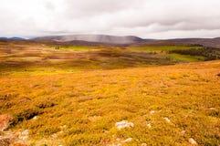 Rainbow over the highlands Stock Photos