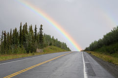 Rainbow over the highway Stock Images