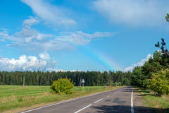 Rainbow over highway Stock Photo