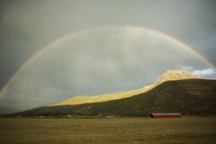 Rainbow over hills. Shot in salmon arm, bc canada Stock Images