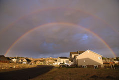 Rainbow Over Homes Royalty Free Stock Photography