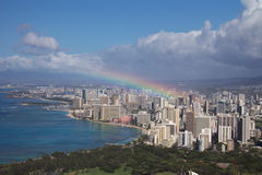 Rainbow over Honolulu. Rainbow emerging from Downtown Honolulu stock images