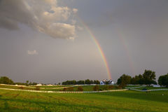 Rainbow over a horse farm Royalty Free Stock Photo