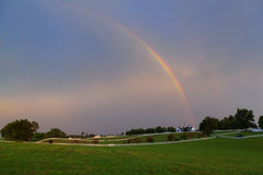 Rainbow over a horse farm Royalty Free Stock Image