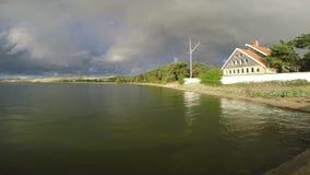 Rainbow over the house, 4K stock video