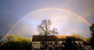 Rainbow over house with trees. In Hannover in Germany Royalty Free Stock Photography