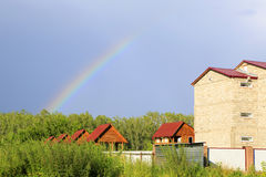 Rainbow over the houses. Royalty Free Stock Photo