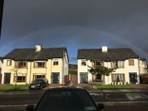 Rainbow over houses in castlebar. Full rainbow over two houses in a small cul de sac in castlebar, county Mayo, west coast of Ireland Stock Photography