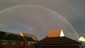 Rainbow over houses Royalty Free Stock Photography