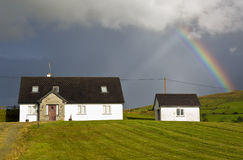 Rainbow over the houses in the Irish countryside, Ireland, Europe. Royalty Free Stock Photo