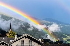 Rainbow over houses stock image