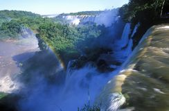 Rainbow over Iguazu Waterfalls in Parque Nacional Iguazu viewed from Upper Circuit, border of Brazil and Argentina Stock Photos
