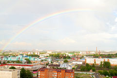 Rainbow over industrial sity. Rooftop view on railroad station of Omsk Royalty Free Stock Image