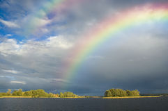 Rainbow over an island Royalty Free Stock Photo