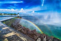 Rainbow next to the Geneva Jet d`eau Fountain. Rainbow over the Jetty next to the Geneva Jet d`eau Fountain royalty free stock photography