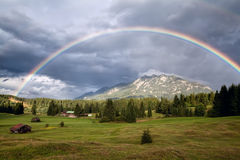 Rainbow over Karwendel Alps and meadows Royalty Free Stock Photos