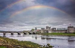 Rainbow over King Johns Castle. In Limerick, Ireland Stock Photo