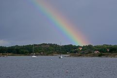 A rainbow over Kosterhavets national park, Sweden. A rainbow arching over Kosterhavet, the first Swedish marine national park Royalty Free Stock Images