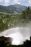 Rainbow over Krimml Waterfalls, Austria. From a height of 380 meters, the mountain waters of the Krimmler Ache, a glacial creek, plunge over three tiers to the Stock Photos