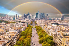 Rainbow over the La Defense Financial District, Paris, France in spring. Royalty Free Stock Image